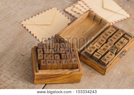 Wooden Stamps Alphabet And Vintage Envelopes