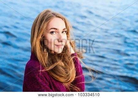 Girl With Long Flying Hair On A Background Of Ripple