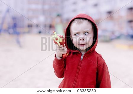 child with a toy gun