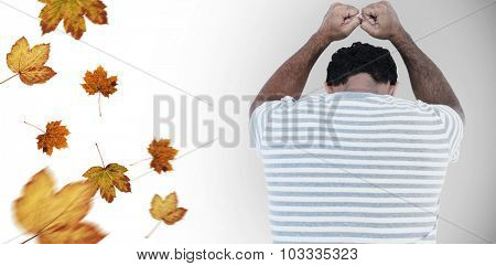 Upset man leaning on white background against autumn leaves pattern
