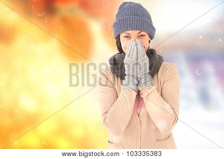 Smiling brunette wearing warm clothes against autumn changing to winter