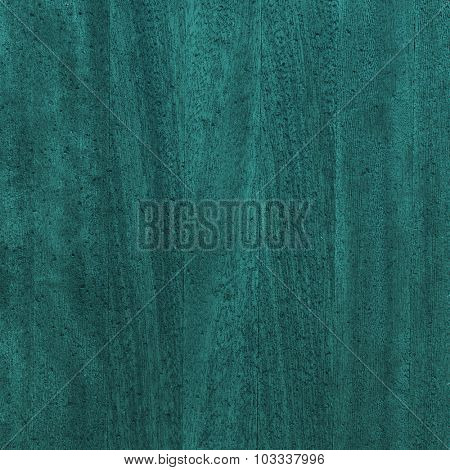 Dark green color stained wooden board. Close up of wooden textured background.