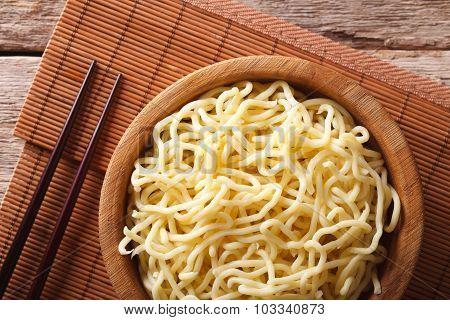 Asian Ramen Noodles In Wooden Bowl Close-up. Horizontal Top View