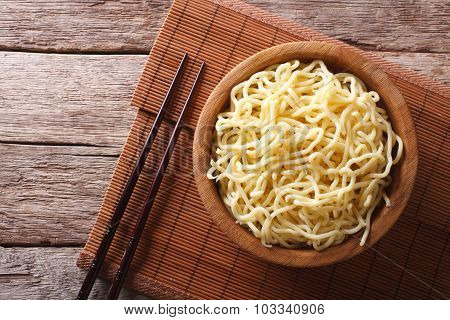 Asian Ramen Noodles In Wooden Bowl. Horizontal Top View