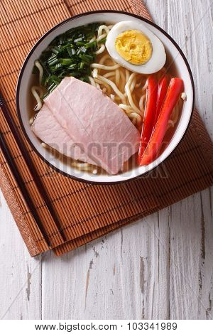 Asian Food: Ramen Noodles With Pork And Egg In A Bowl. Vertical Top View