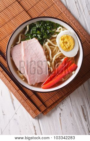 Ramen Soup With Pork, Vegetables And Egg Close Up. Vertical Top View