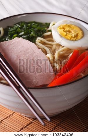 Ramen Noodles With Pork And Egg In A Bowl Close Up. Vertical