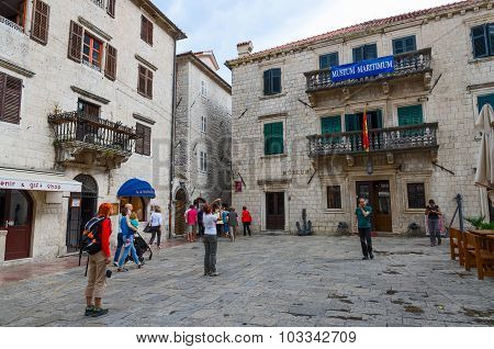 Tourists Are Near Maritime Museum On Square Of Old Town, Kotor, Montenegro