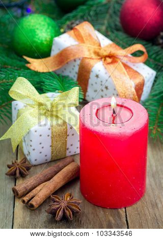 Christmas Composition With Gift Box, Spices And Candle, Closeup