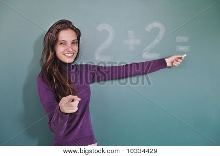 Math Teacher In Front Of Blackboard