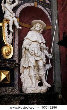LJUBLJANA, SLOVENIA - JUNE 30: The statue of the Saint Roch on the altar in the Franciscan Church of the Annunciation in Ljubljana, Slovenia on June 30, 2015