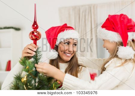 Mother And Dughter Decorating Christmas Tree