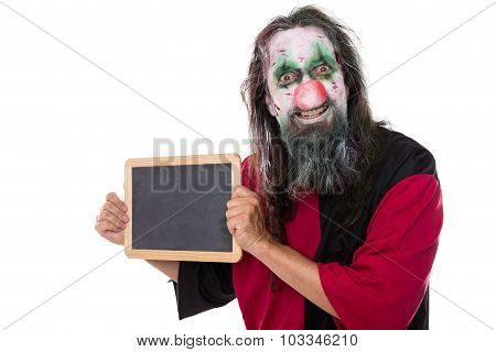 Creepy Clown Holding A Sign With Copyspace, Isolated On White