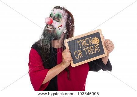 Scary Clown Holding A Sign, Text Trick Or Treat, Isolated On White, Concept Halloween