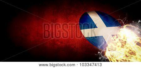 scotland rugby ball against dark background