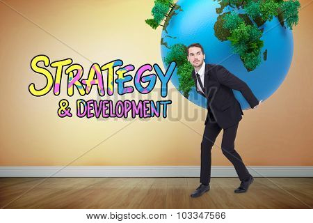 Businessman carrying the world against room with wooden floor