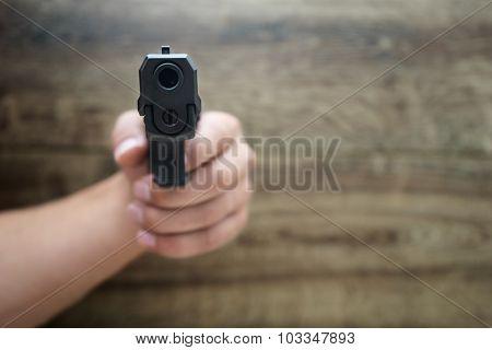 ?asculine Hand Holding Pistol Gun