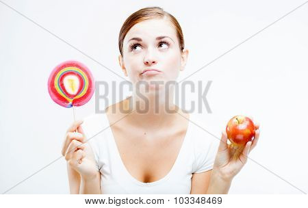 Woman Choosing Between Sweets And Fruits