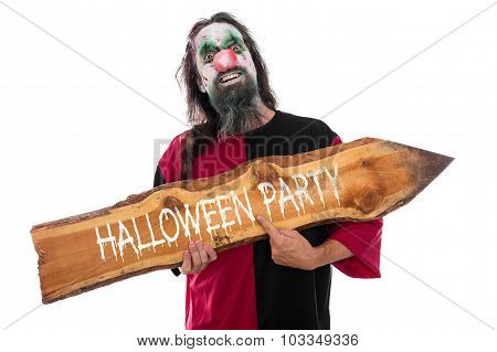 Creepy Clown Holding A Wooden Arrow With Text Halloween Party, Isolated On White