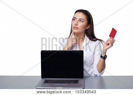 Business woman with laptop showing credit card