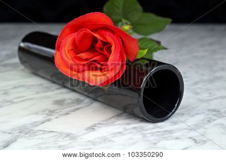 Red Rose With Black Vase On A Marble Table