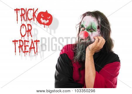 Scary Clown Looking To Text Trick Or Treat, Isolated On White, Concept Halloween