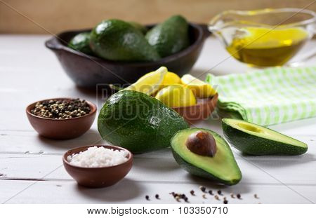 Avocado and other ingredients for sauce guacamole on the table. Selective focus