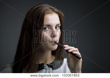 Elegant Beautiful Woman Holding E-cigarette