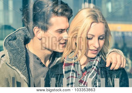 Affectionate Couple Of Lovers Behind Glass Reflections - Young Man Whispering Magic Words In The Ear