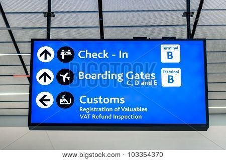 Info Sign At International Airport - Directions For Check In And Boarding Gates
