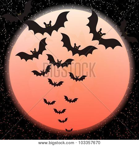 Bats against a disk of the red moon