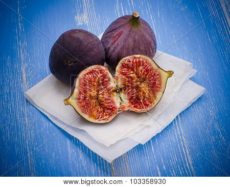 Three Ripe Figs On Baking Paper Blue