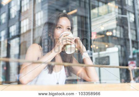 Beautiful Girl Enjoying An Hot Coffe Inside A Shop In New York