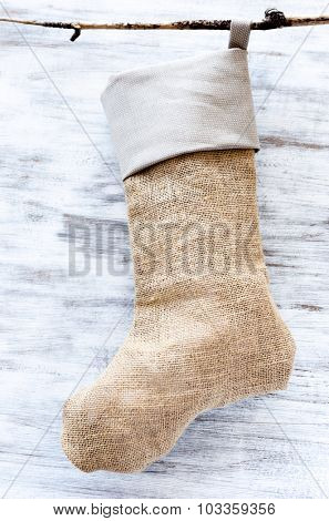 Hessian christmas stocking on rustic grungy white background