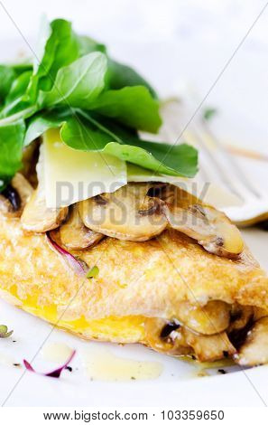 Close up of omelette with sauteed mushrooms with fresh rocket, delicious wholesome breakfast
