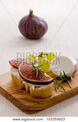 Feta Cheese With Ripe Figs And Grapes