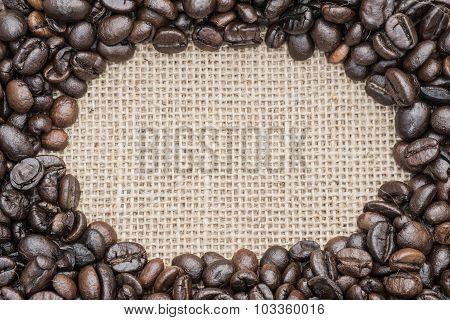 Fresh coffee beans on hessian