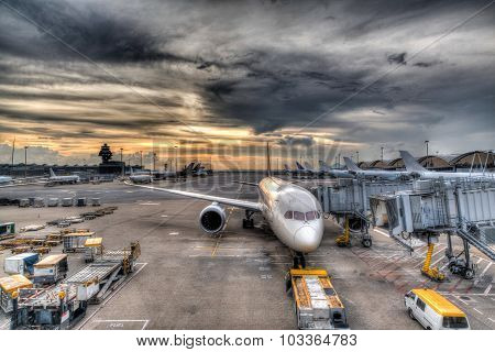 Sunset Over Commercial Aircrafts On Airport Tarmac