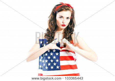 Pin Up Girl Wrapped In American Flag With Hand In Heart Form