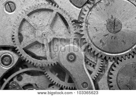 Black-and-white Metal Cogwheels In Oldest Clockwork, Macro.