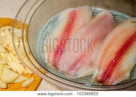 Cooking Red Filets Of Tilapia On Steam