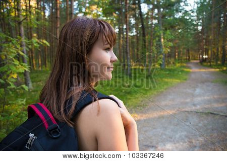 Travel Concept - Woman With Backpack Hiking In Forest