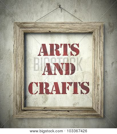 Arts And Crafts In Old Wooden Frame On Wall
