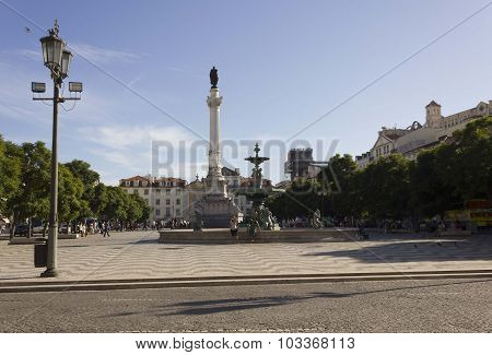 Pedro Iv Column And Fountain In Rossio Square In Lisbon
