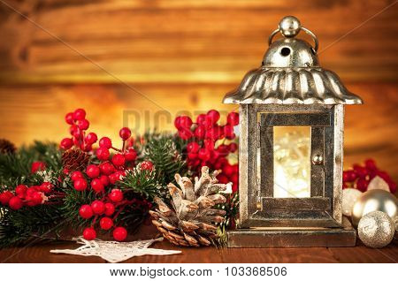 Christmas lantern with fir and tinsel. Illustration