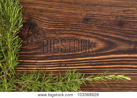 Rosemary On Wooden Table.