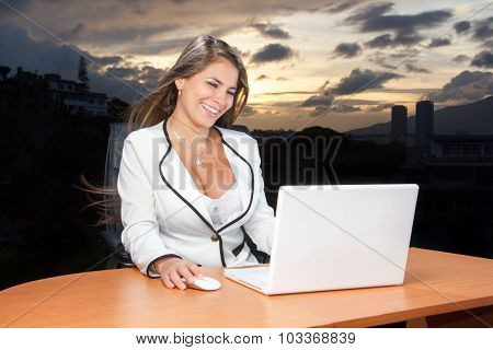 Business Woman Very Happy Looking Laptop In The Sunset