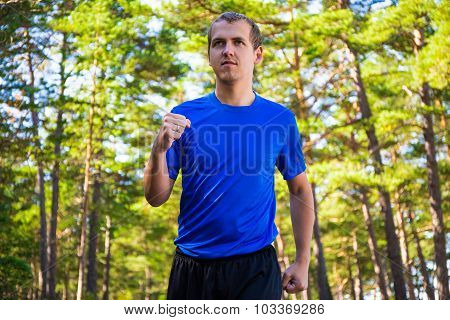 Sport Concept - Male Runner Jogging In Forest