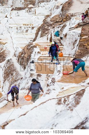 Workers In Salt Basins On The Peruvian Andes