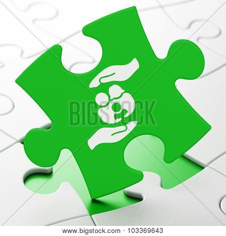 Insurance concept: Family And Palm on puzzle background
